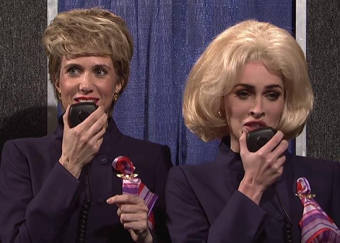 "Kristen Wiig and Megan Fox in a flight attendant sketch on ""Saturday Night Live"""
