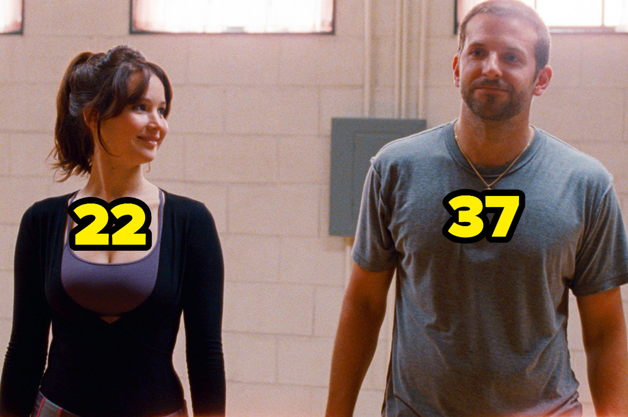 22-year-old Jennifer Lawrence looking at 37-year-old Bradley Cooper