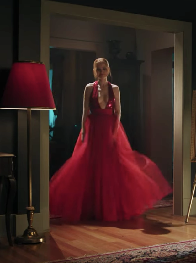 Cheryl Blossom wearing a dress with a deep V cut, a sequined bodice, and a tulle skirt