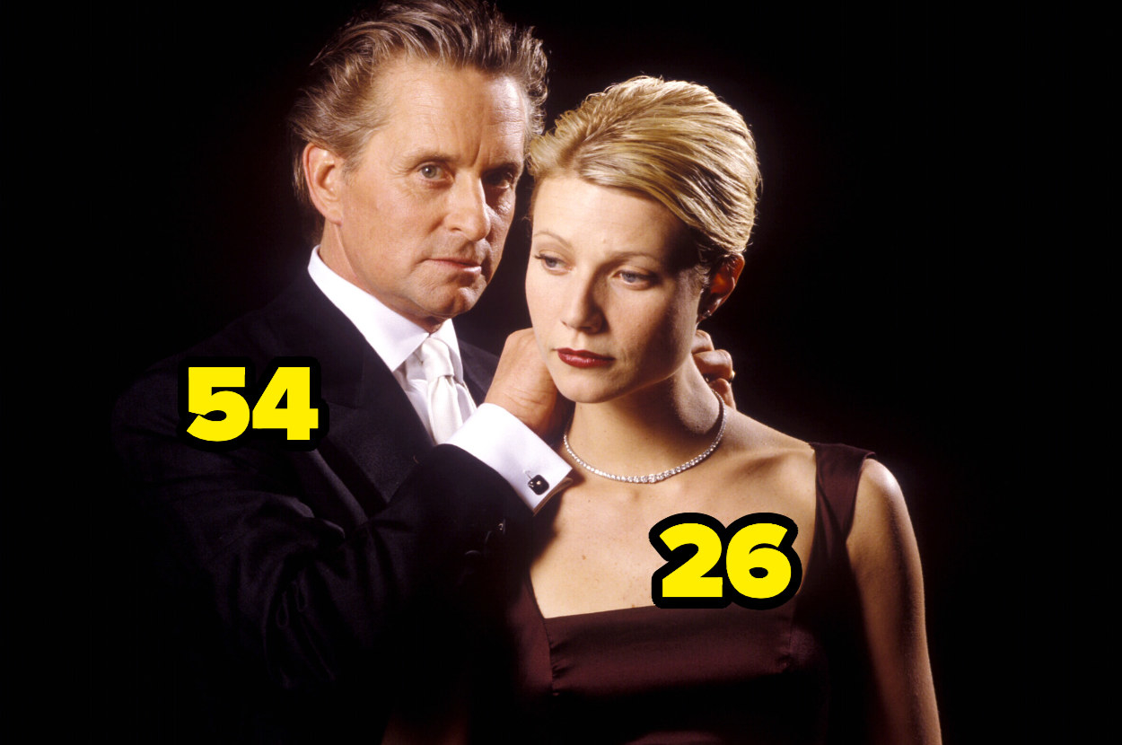 54-year-old Michael Douglas putting a necklace on 26-year-old Gwyneth Paltrow