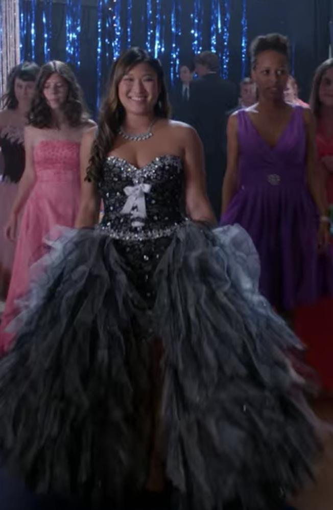 Tina wearing a huge black ballgown
