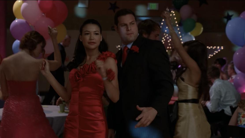 Santana dancing in her red dress