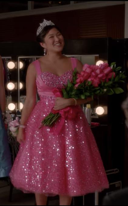 Tina in a tea-length pink glittery dress