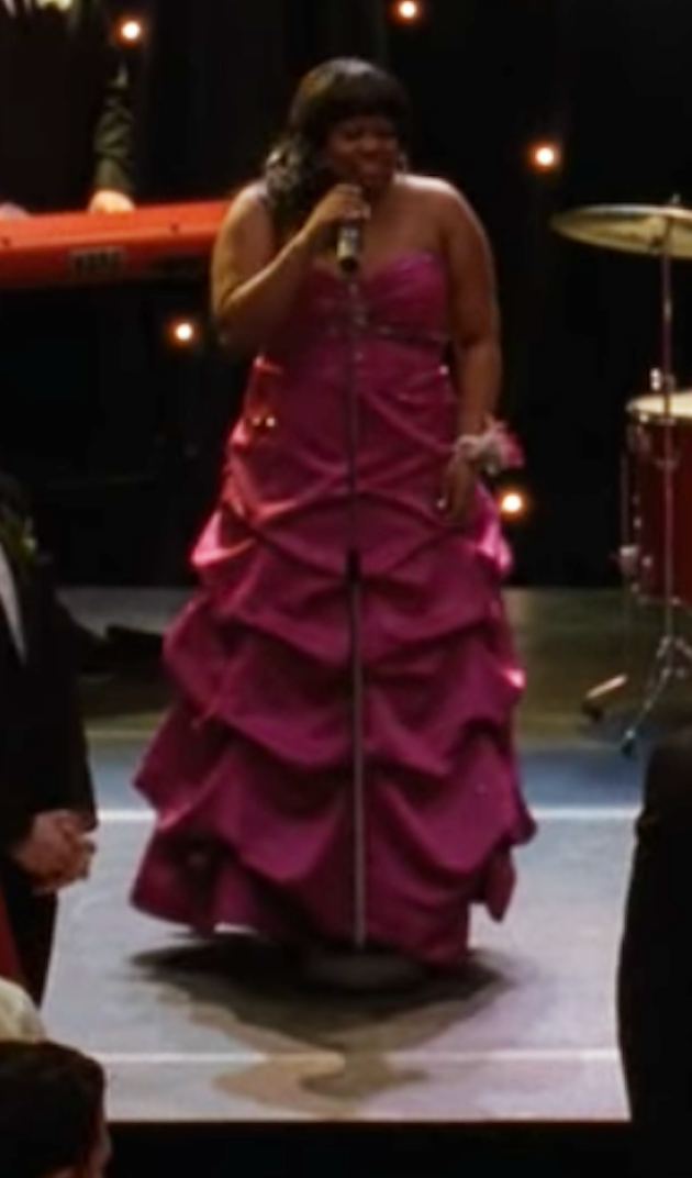 Mercedes wearing a purple bejeweled gown
