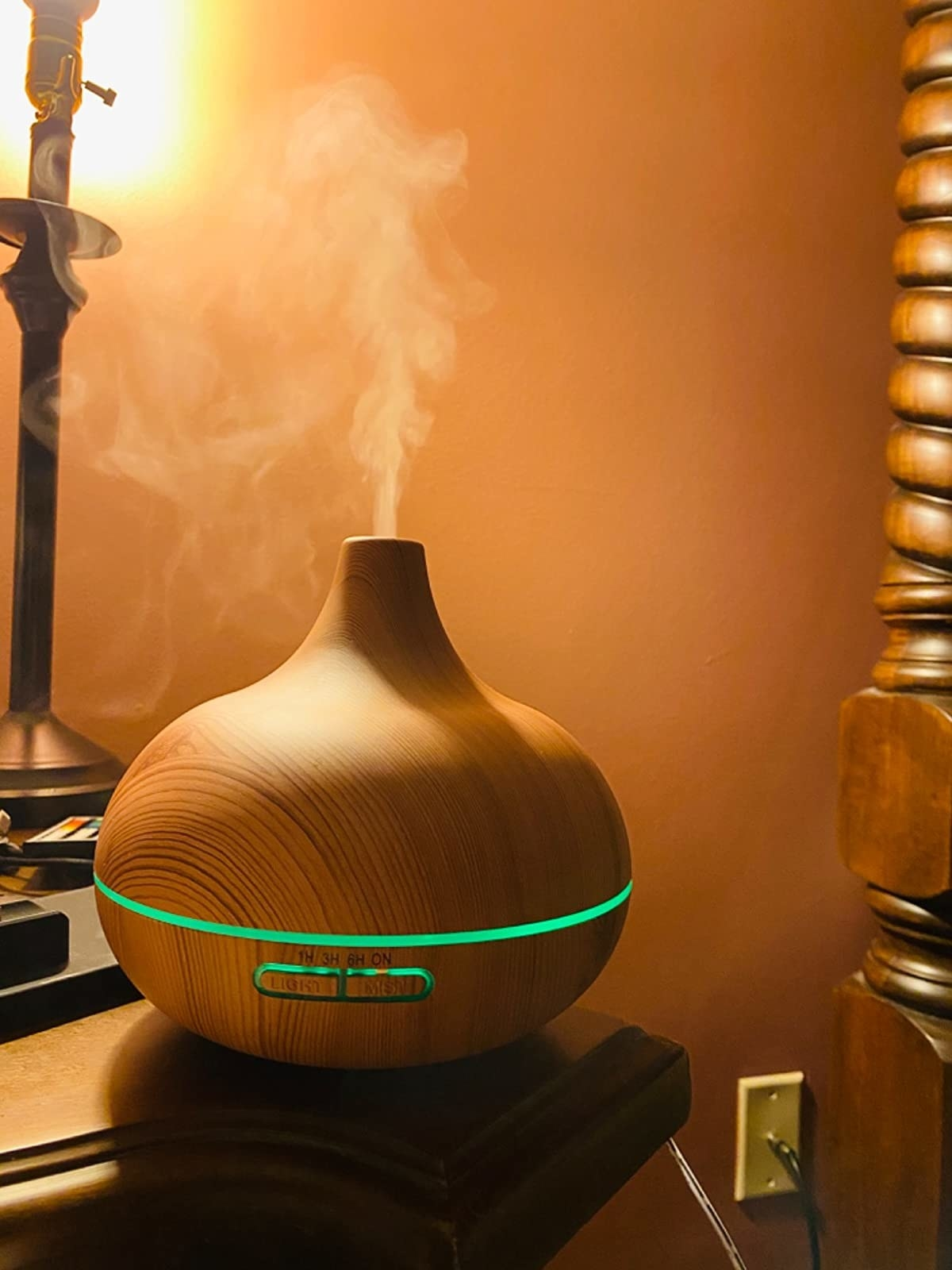 A reviewer's diffuser letting off steam and glowing green