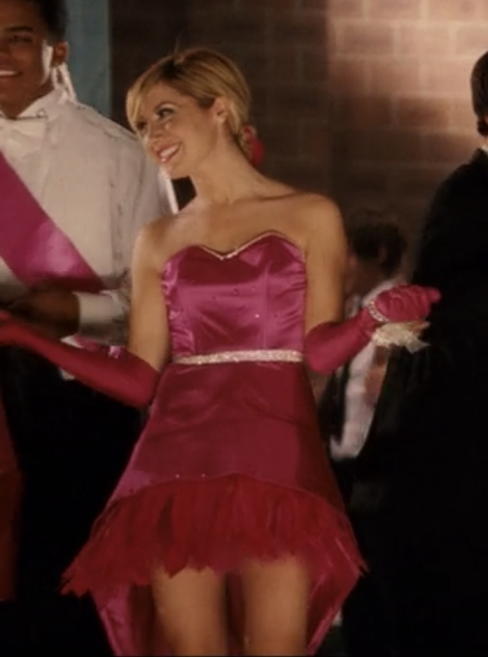 Sharpay in a dress with an uneven bottom and pink feathers adorning the skirt