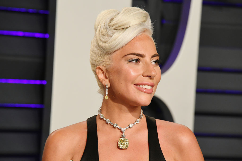 Lady Gaga at the Oscars with an elaborate updo and canary yellow diamond necklace