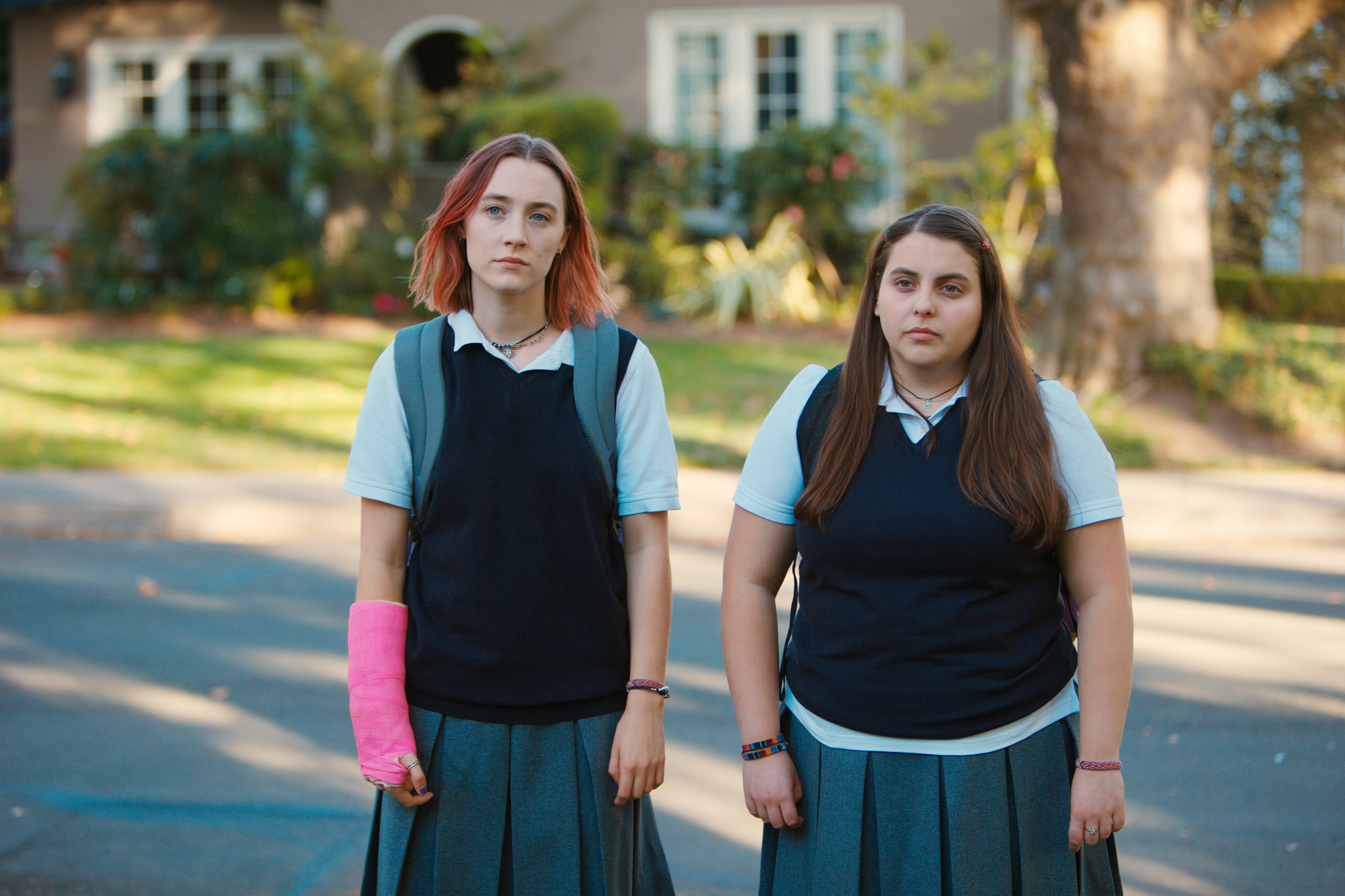 """Christina and Julie standing in a parking lot on """"Lady Bird"""""""