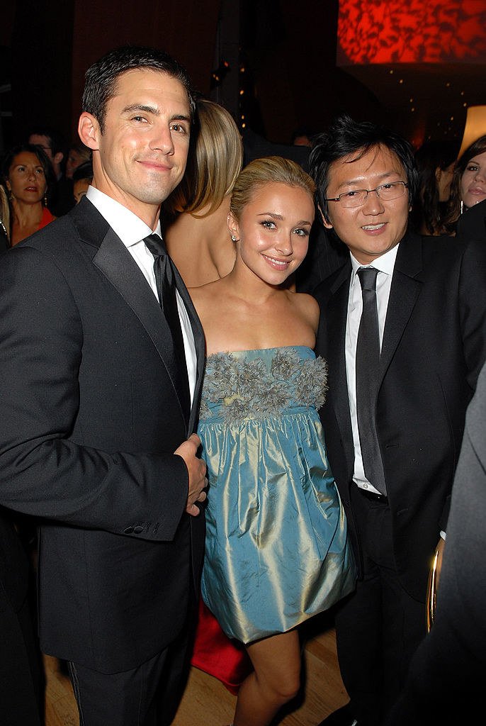 hayden in a blue shiny dress with milo