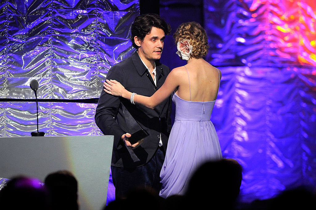 taylor is giving him an award