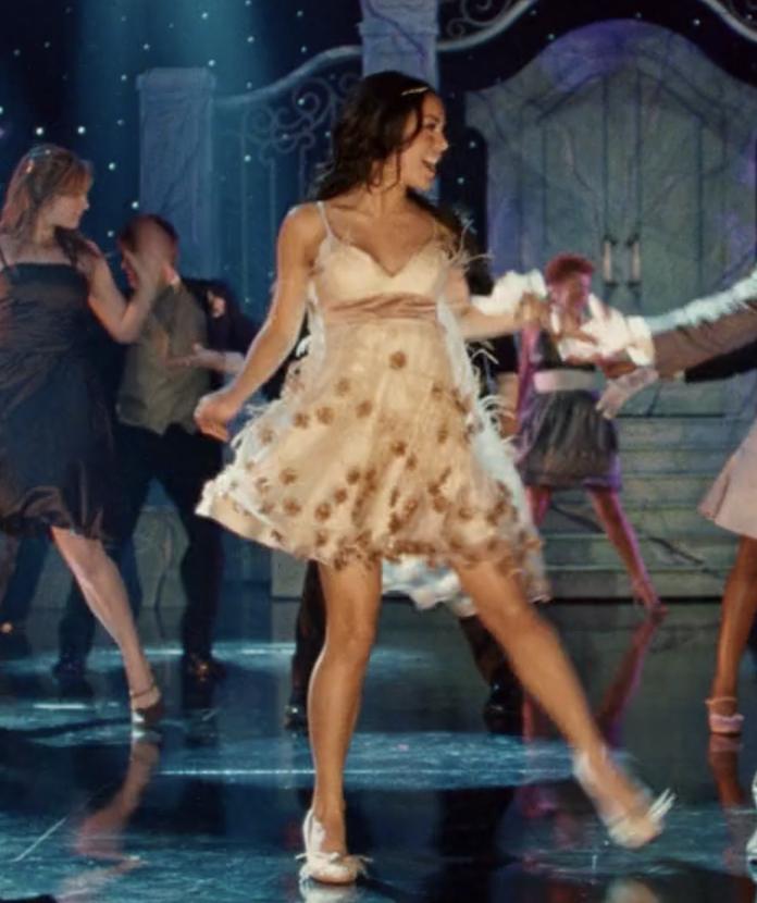 Gabriella dancing in her white dress
