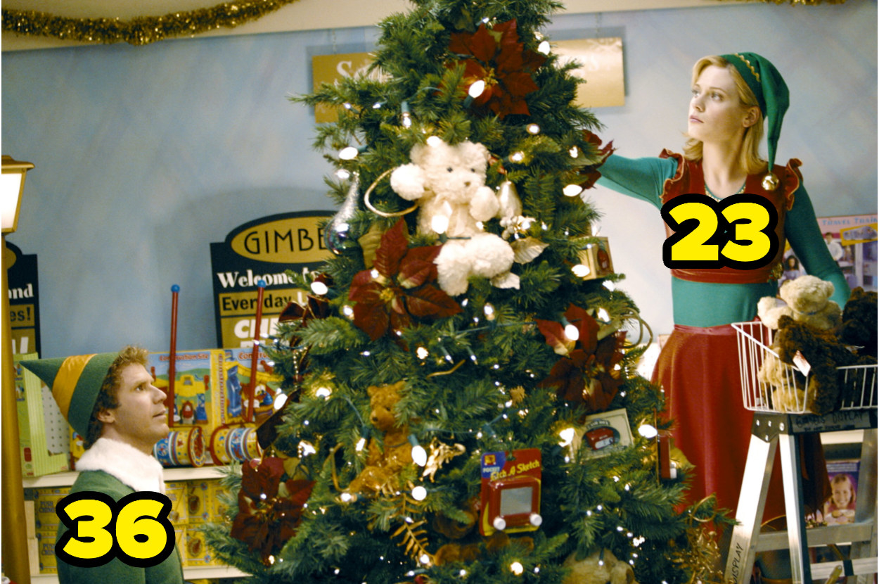 36-year-old Will Ferrell decorating a Christmas tree with 23-year-old Zooey Deschanel
