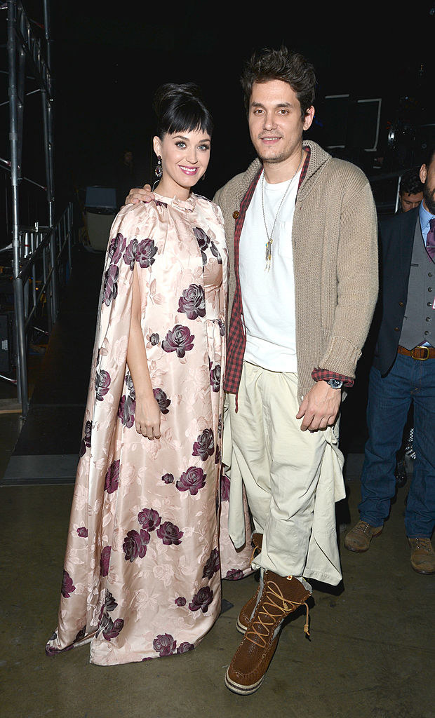 katy perry in a dress that looks like a curtain posing with mayer