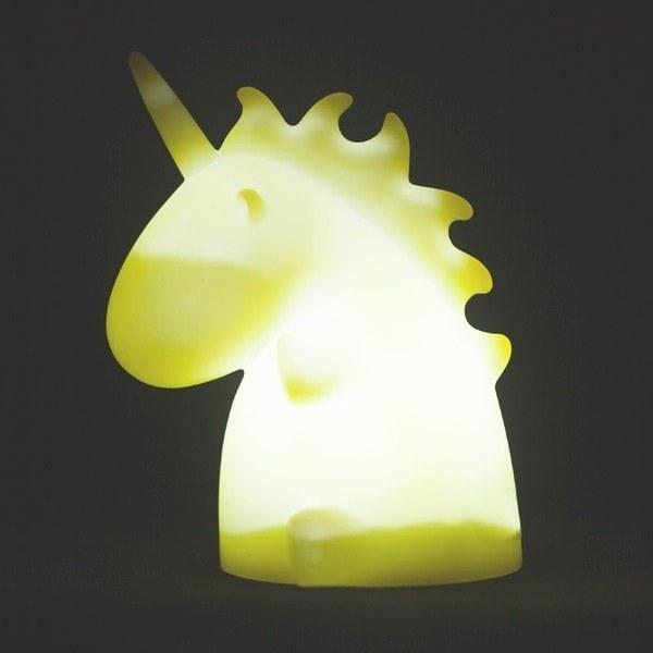 The yellow unicorn light on a shelf