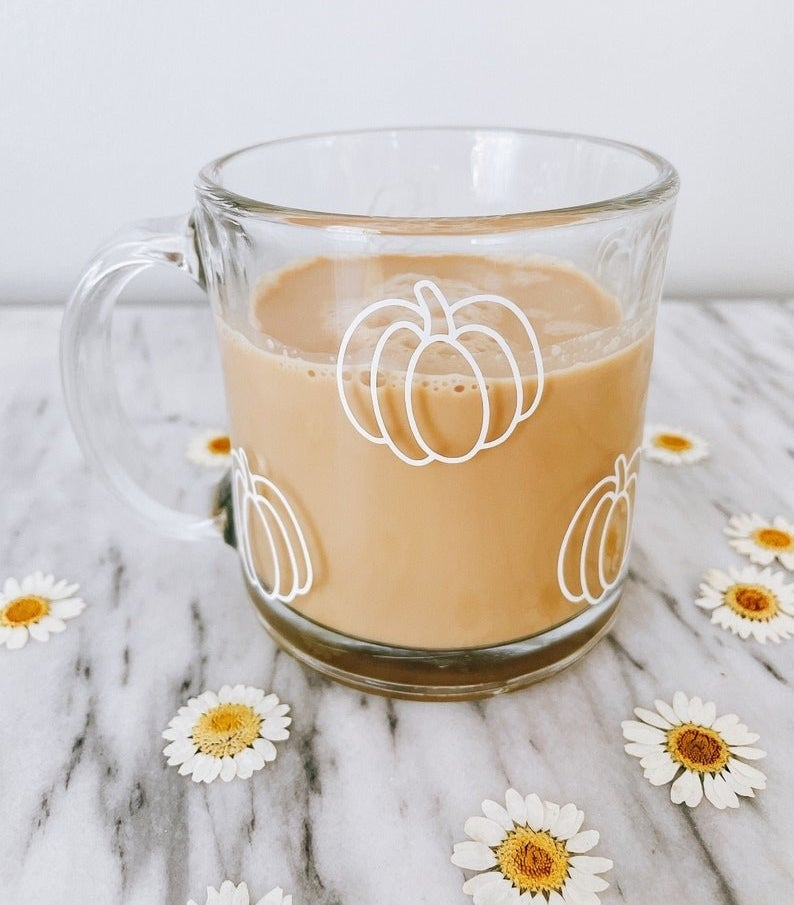 clear mug with white pumpkins printed on it