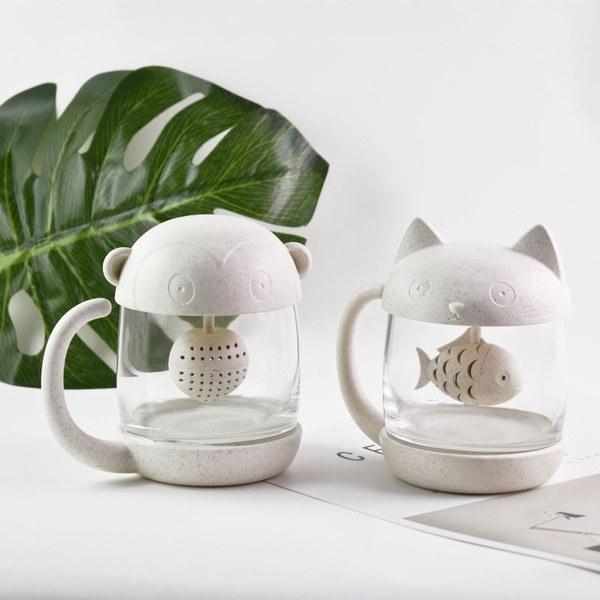 two animal-shaped mugs with tea infuses inside