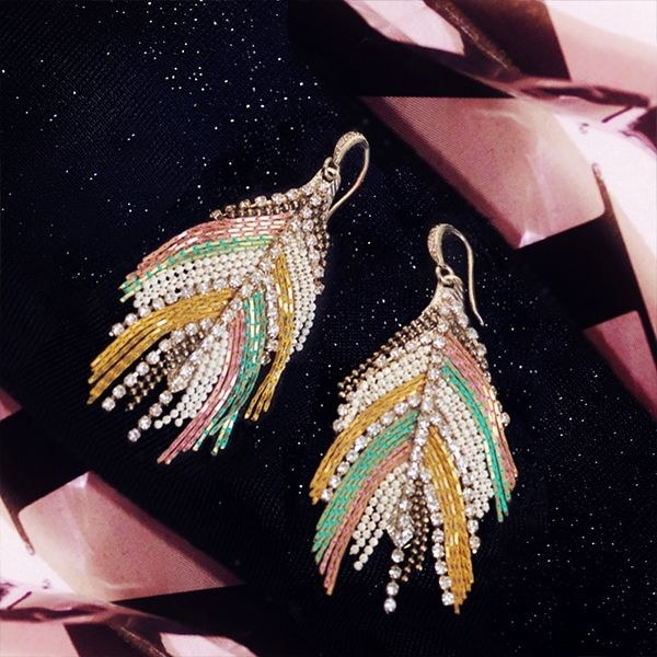 The earrings with colorful accents and crystals