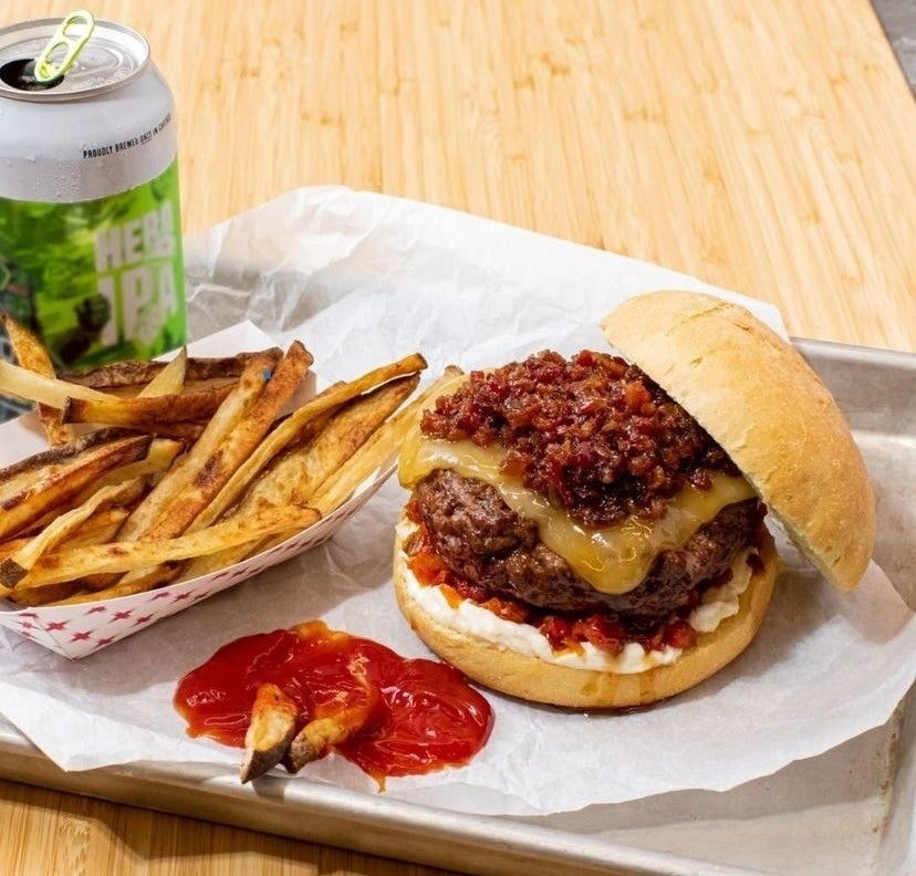 A picture of smoked gouda burger with bacon jam and french fries
