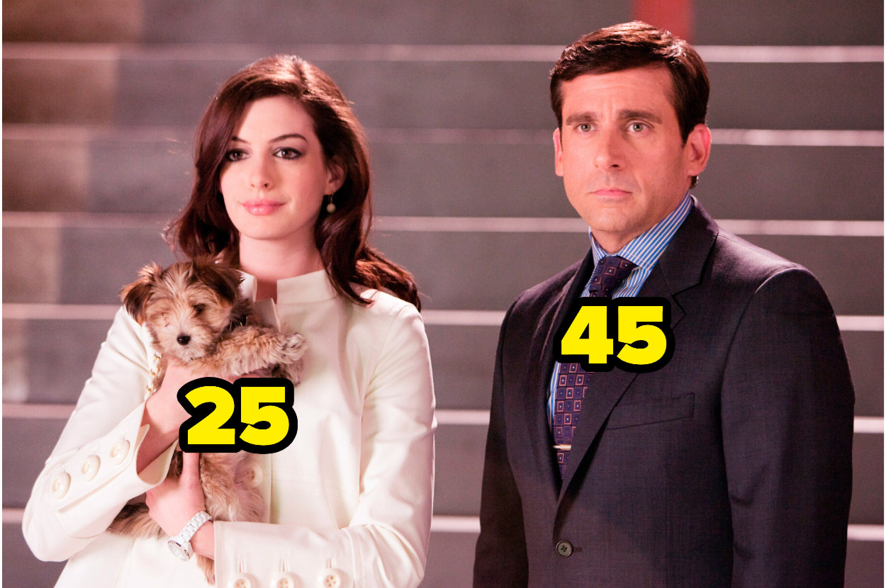 25-year-old Anne Hathaway, holding a puppy, stands next to 45-year-old Steve Carrell