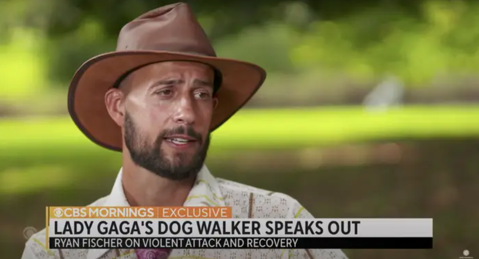 Still from an interview with Ryan Fischer with a chyron: Lady Gaga's Dog Walker Speaks Out