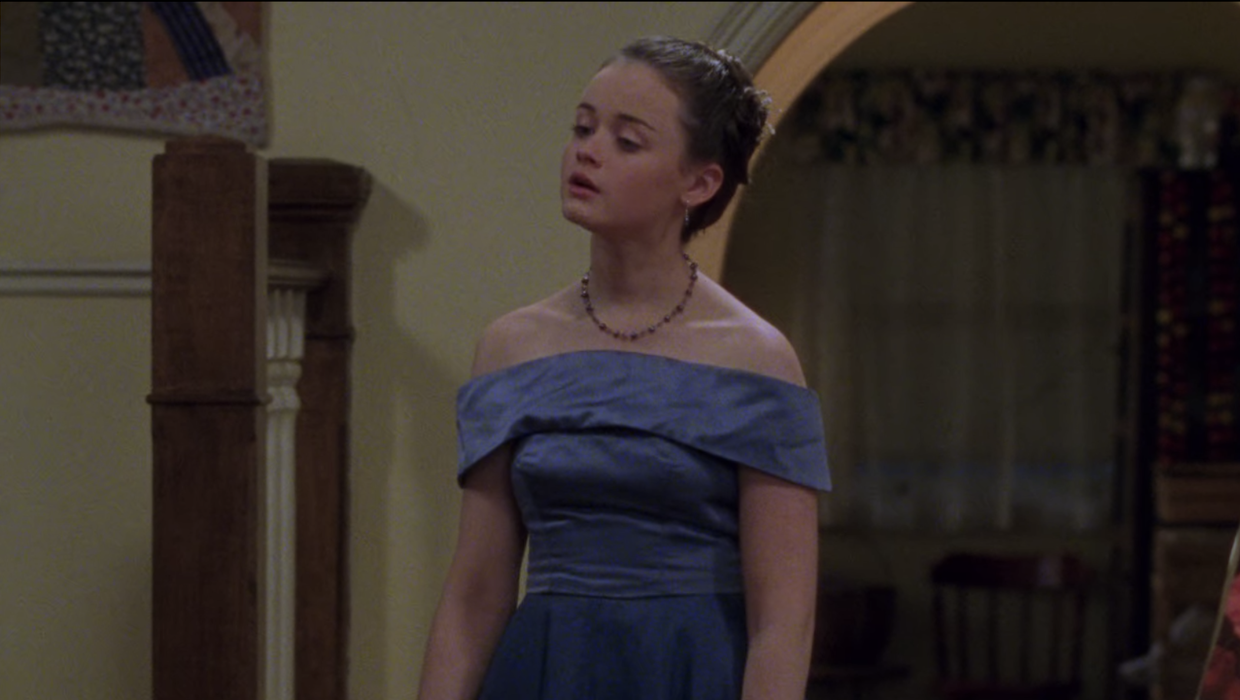 Rory sighing in her dress