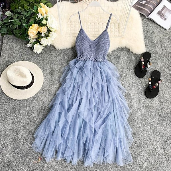 The dress with a ruffled bottom and matching knit top