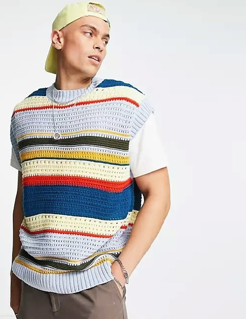a model wearing the striped vest
