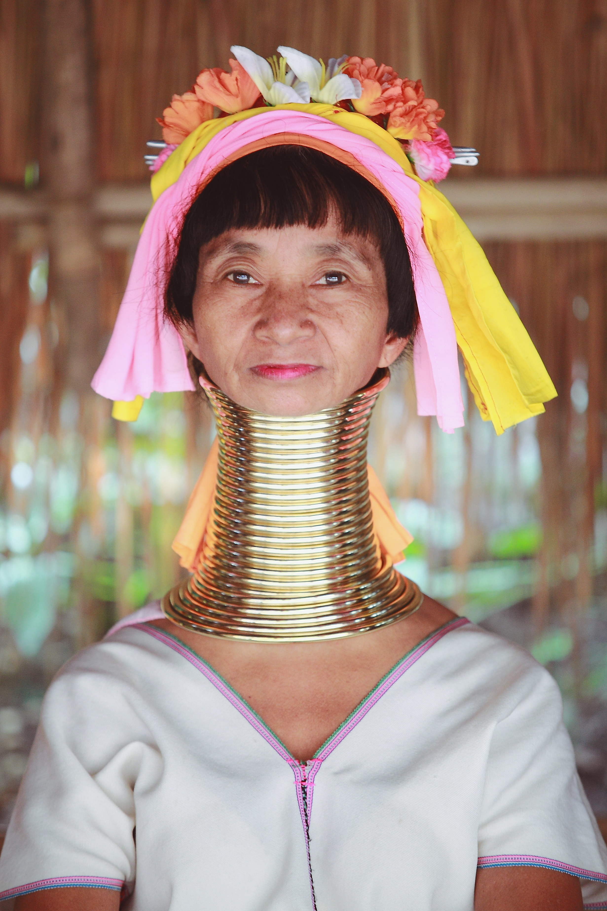 Photo of a woman's elongated neck with brass coils