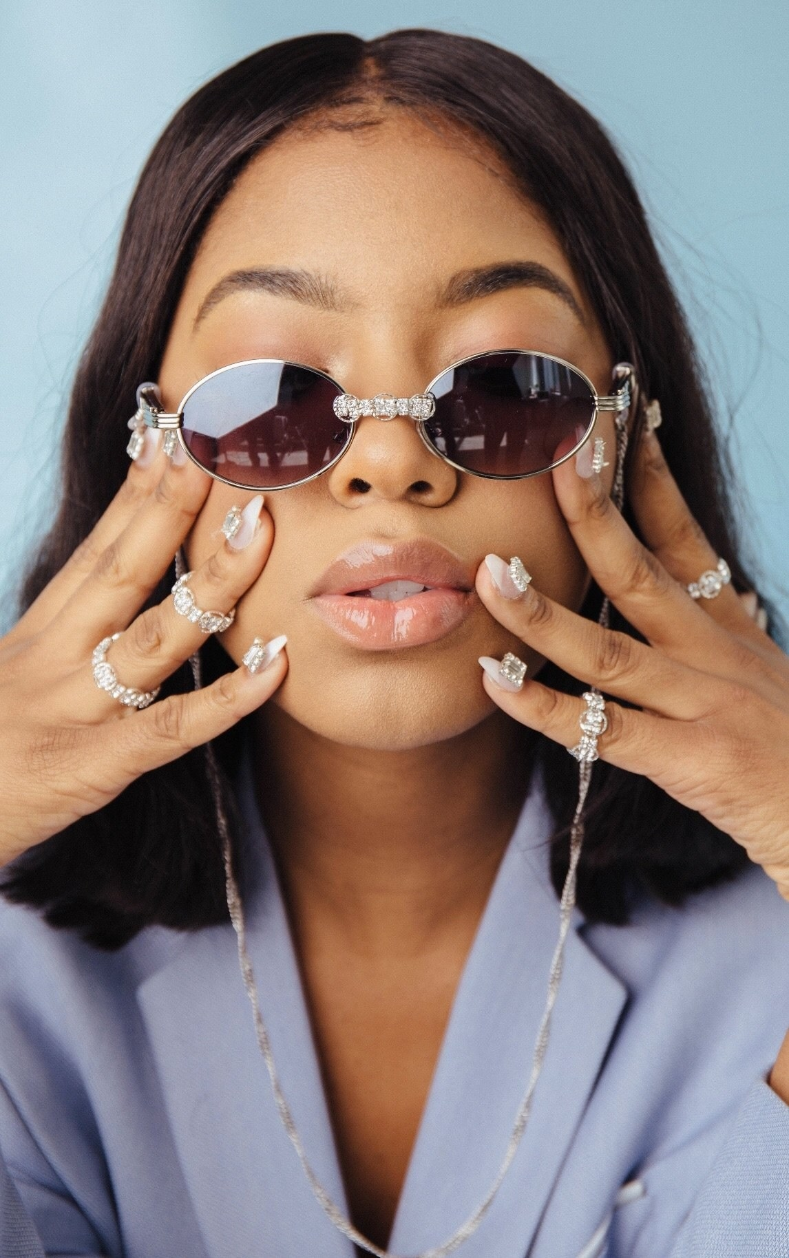 someone wearing the crystal rings with silver loops on multiple fingers