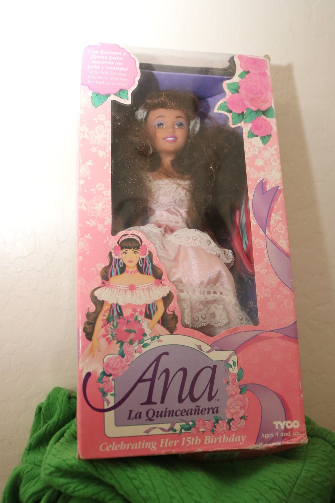 An Ana La Quinceanera doll in her box