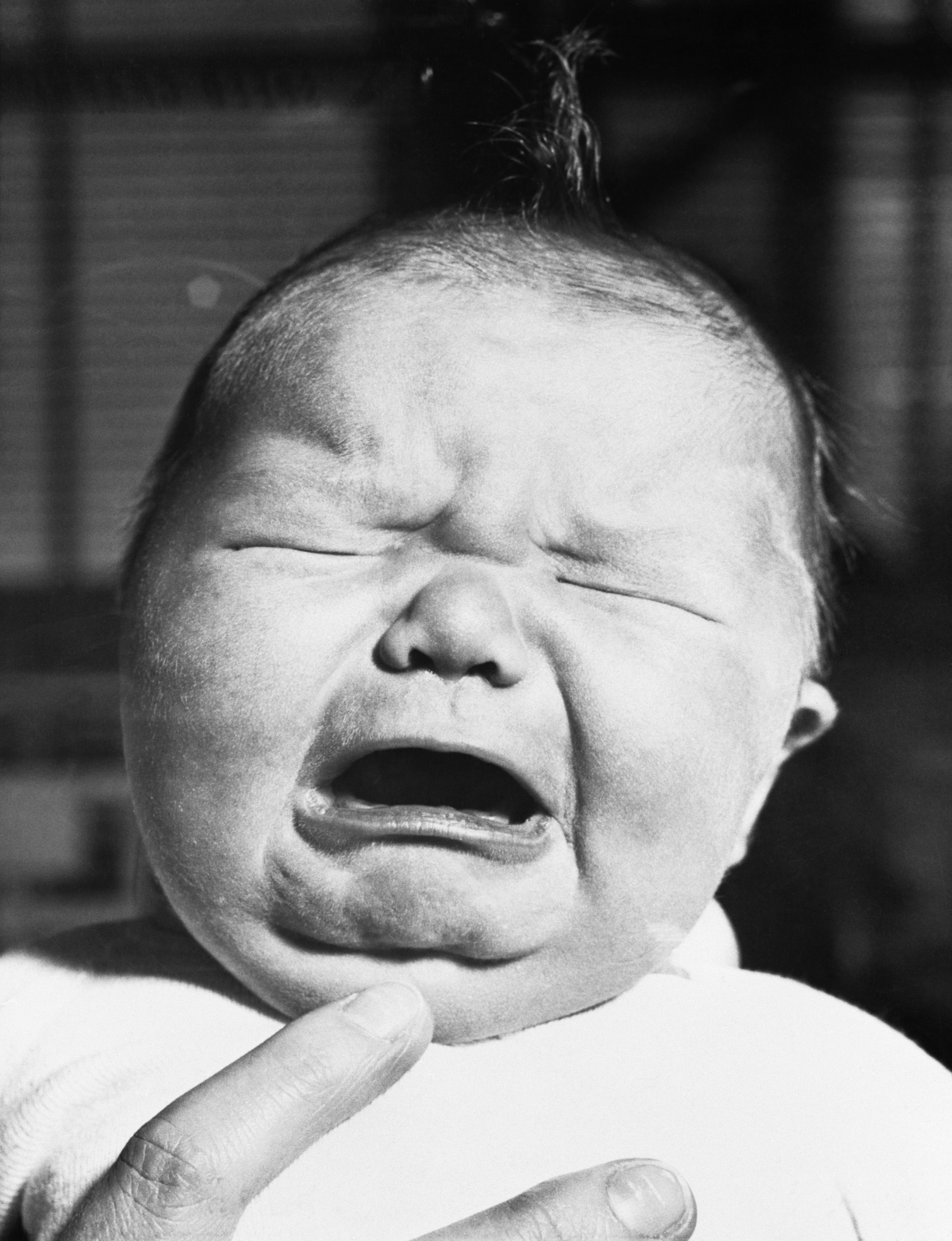 A large baby cries