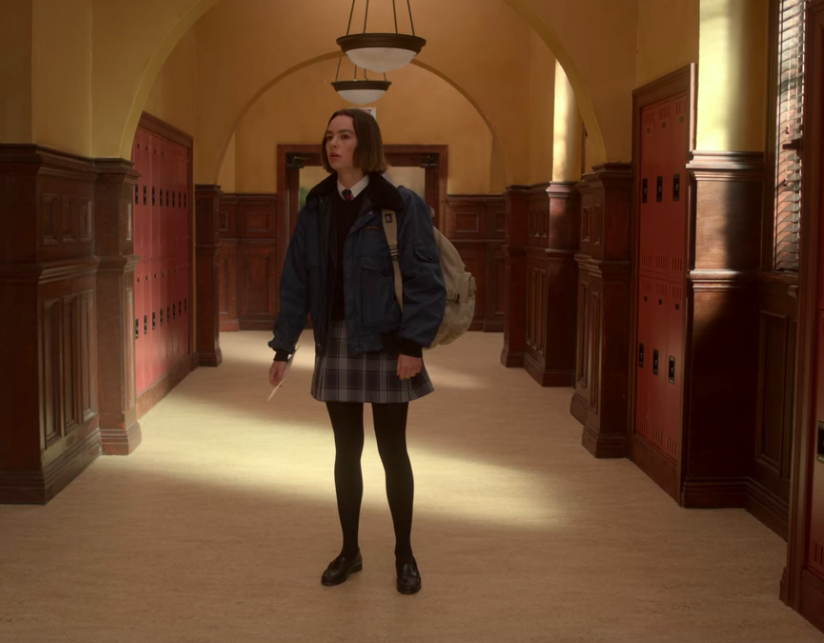 """Casey standing in the middle of the hallway at her new school on """"Atypical"""""""