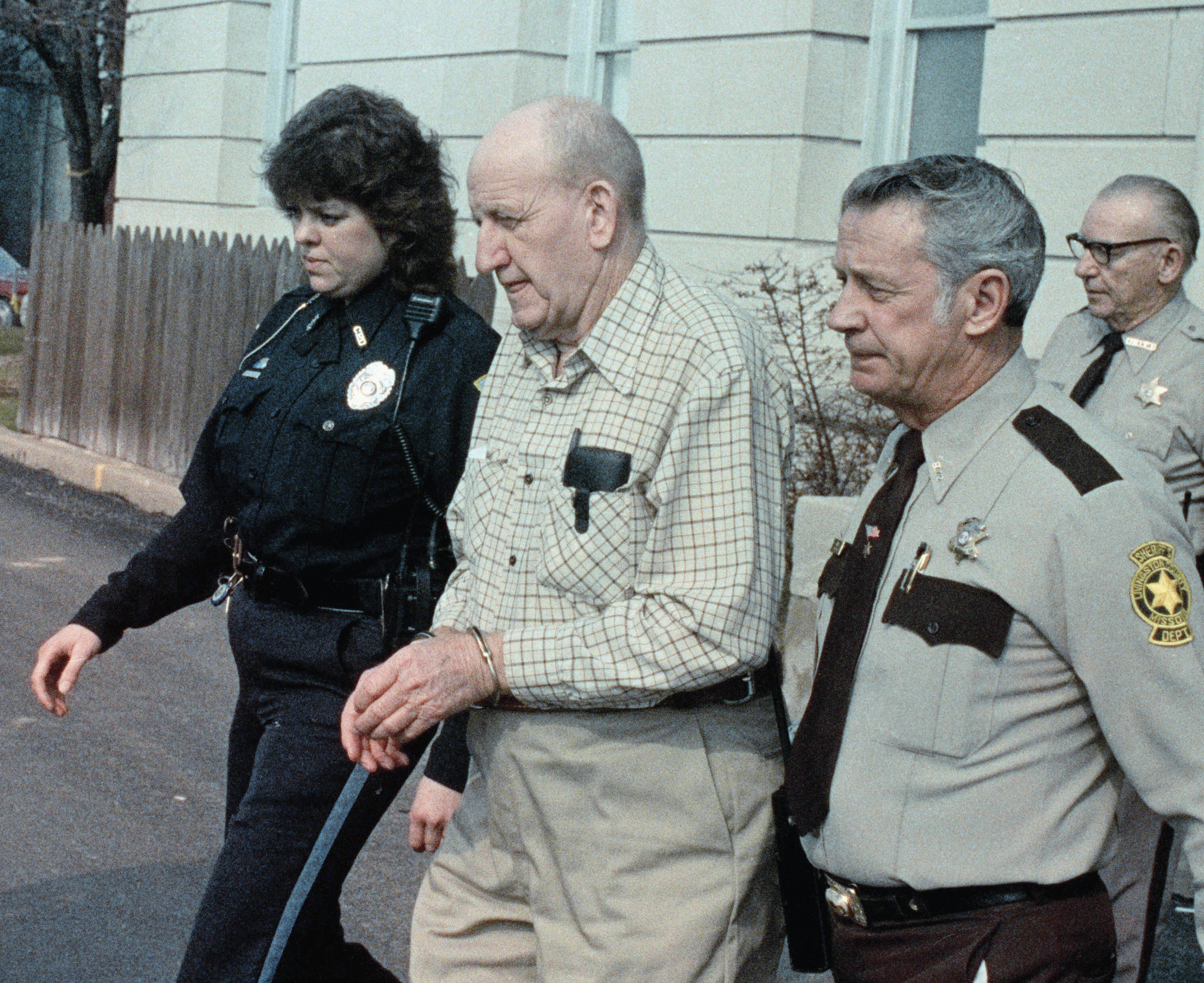 Ray Copeland being escorted to jail