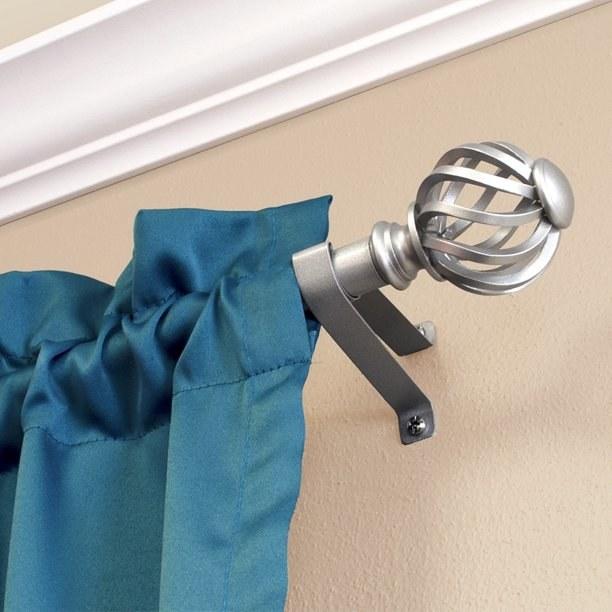 Nickel curtain rod on wall