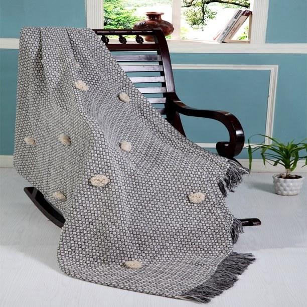 grey blanket on chair