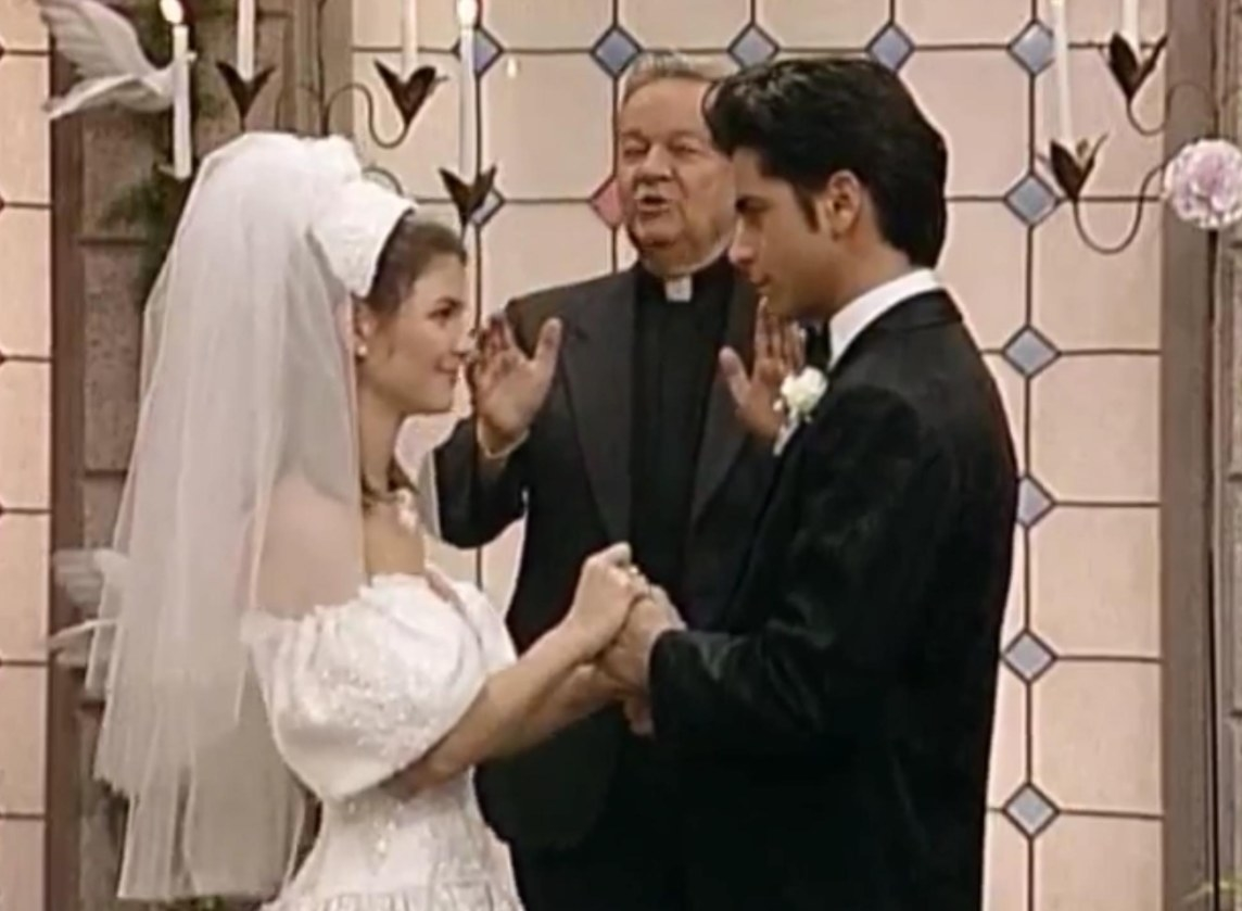 Rebecca and Uncle Jesse get married in front of a priest