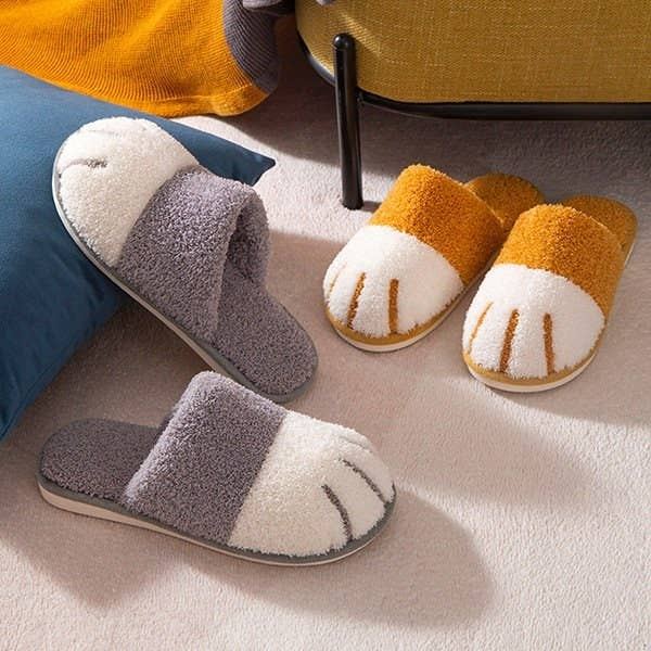 The cat paw slippers with an open back in a bedroom