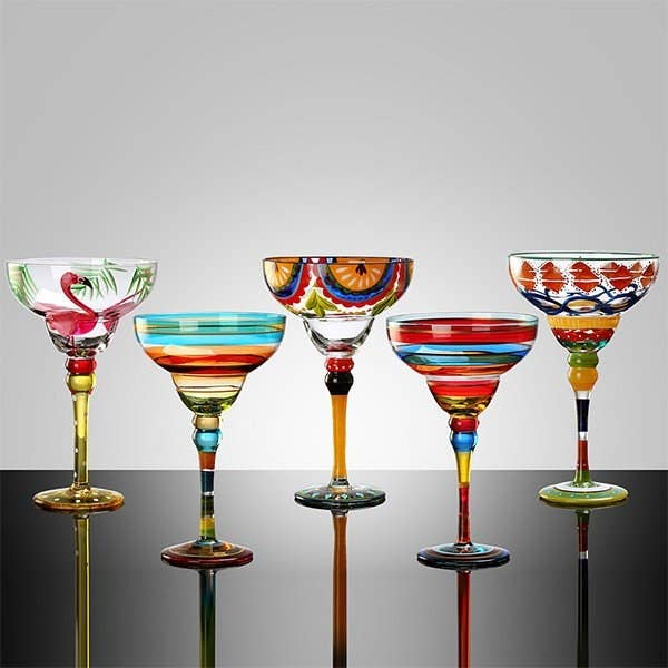 Five margarita glasses in a row each with a different design
