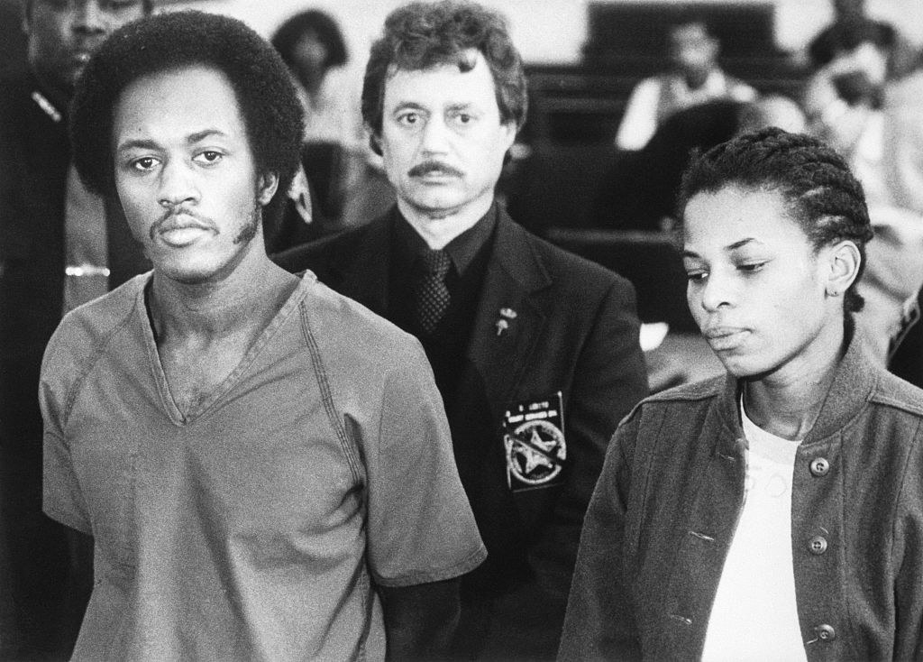 Alton Coleman and Debra Brown standing in a courtroom
