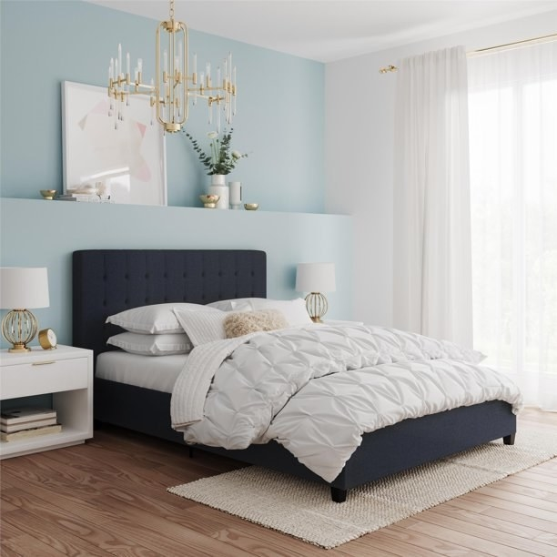 blue bed with white comforter