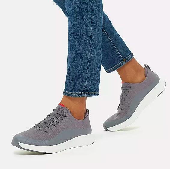 Foot model wearing the grey sneaker