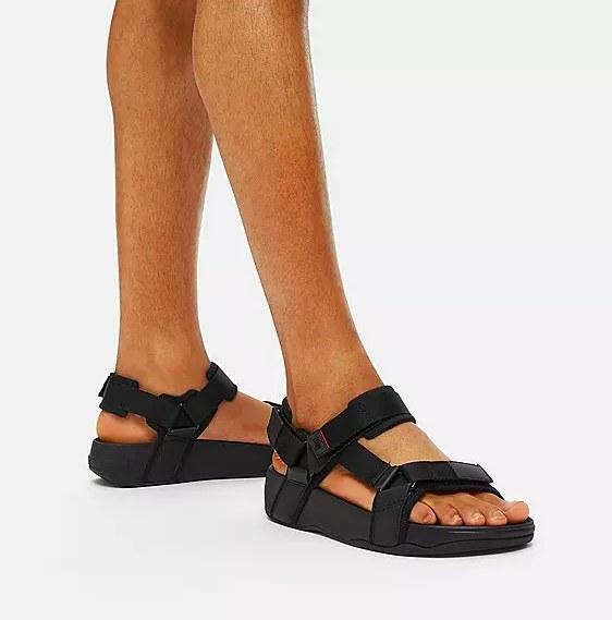 Model wearing the black sandals