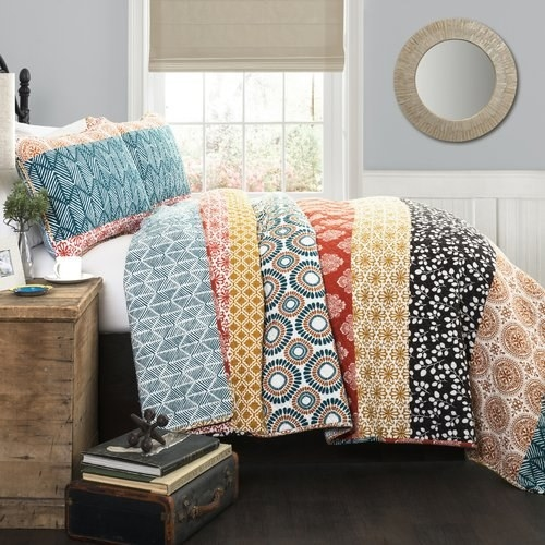 colorful bedspread on bed