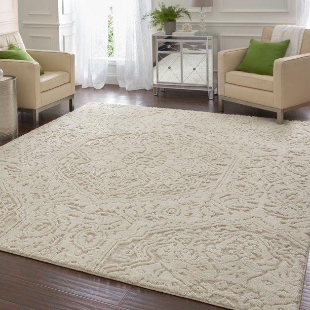 a beige medallion area rug