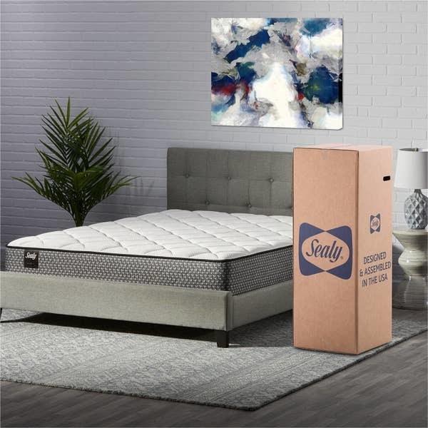 mattress on grey bed frame