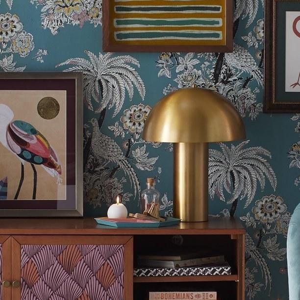 gold lamp on wooden dresser