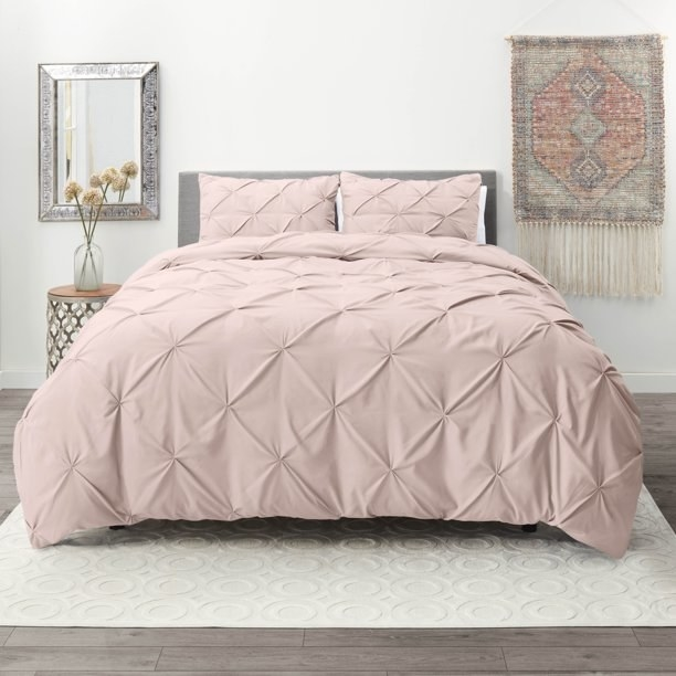 pink tapered bedspread on bed