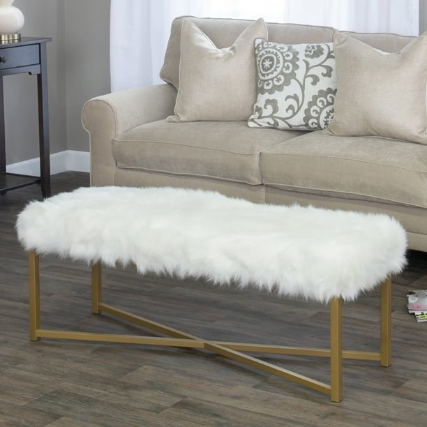 white and gold fur bench