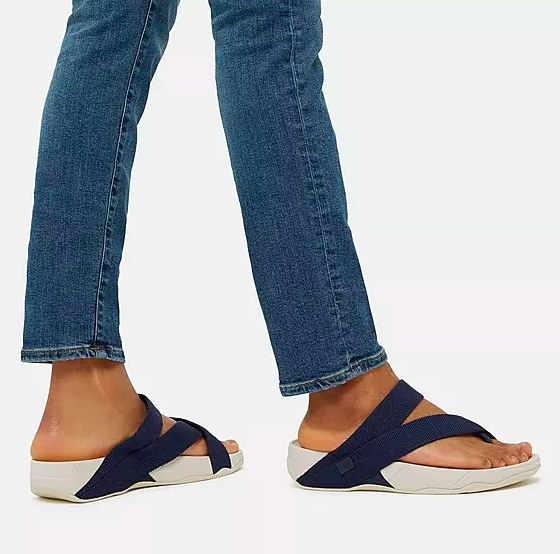 Model wearing the blue sandals