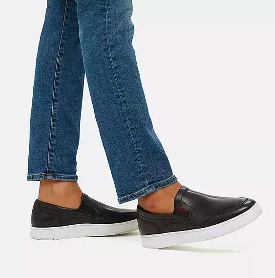 Model wearing the sneaker in black